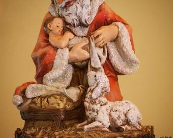 Unique Tree Topper - Kneeling Santa with Baby Jesus