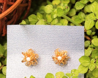 Gold field wire flowers earrings.