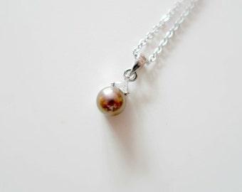 CRISTINA . brown cultured pearl pendant and chain . 14K GP