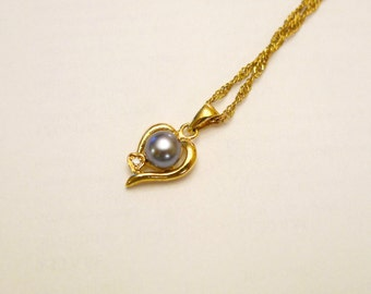 CHARLOTTE .  Black Cultured pearl pendant and chain . GP 14K