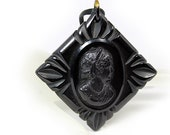 Carved Black Bakelite Cameo Pendant