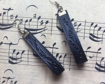 Black hand carved leather earrings