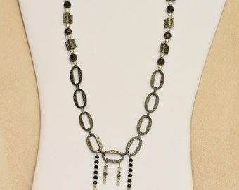 Necklace with metal black ovals, crystals, beaded with four crystal drops