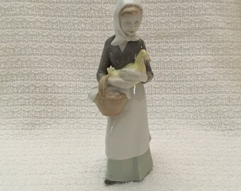Carl Scheidig Woman with Basket Holding Yellow Duck Figurine, Carl Scheidig Porcelain Figurine, Lady with Scarf and Duck Figurine, Germany