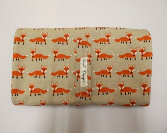 Padded. Compact folding nappy diaper wallet,pouch, clutch with waterproof baby changing mat. All in one. Orange fox.