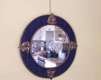 A unusual quirky retro vintage 1950's blue and gold wall mirror
