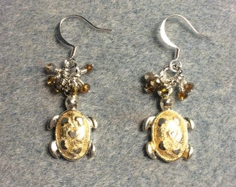 Tan enamel turtle charm earrings adorned with tiny dangling tan Chinese crystal beads.