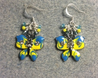 Turquoise and yellow enamel and rhinestone butterfly charm earrings adorned with tiny dangling turquoise and yellow Chinese crystal beads.