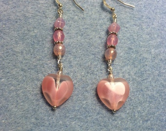 Pink Czech glass heart bead dangle earrings adorned with pink Czech glass beads.