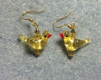 Transparent yellow songbird bead dangle earrings adorned with yellow Czech glass beads.