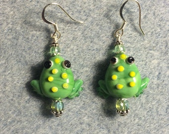 Opaque light green lampwork frog bead earrings adorned with light green Czech glass beads.