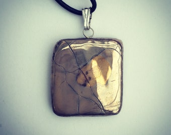 Silver and gold square pendant.