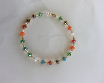 Beaded anklet with barrel clasp.