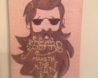 Dark brown bearded man on a burlap stretched canvas.