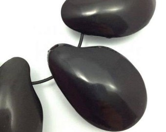 Tagua Nut, black, two-sided 42 mm, flattened,