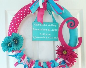 Door wreath for new baby, with birth announcement.