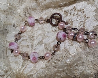 beaded pink part and artist glass rose bracelet with tassels
