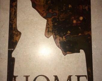 Idaho home, rusted metal sign.