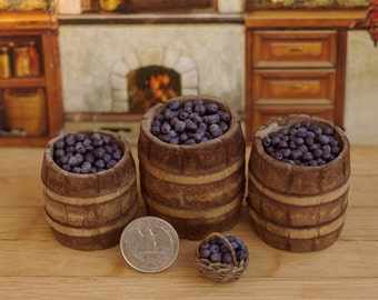Garden plum miniature  dollhouse. Garden barrels with plums. Garden plum miniature. Plums in the basket.
