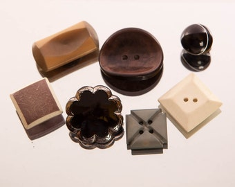 Assorted buttons, seven buttons, variety, round button, flower button, square button, rectangular, curved, patterned, vintage buttons,