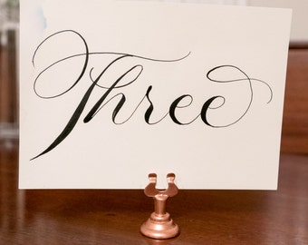 Set of 15 rose gold table number holders