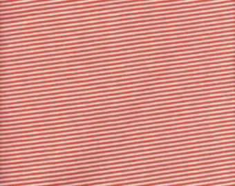1 yard 11-inches of orange/white jersey knit