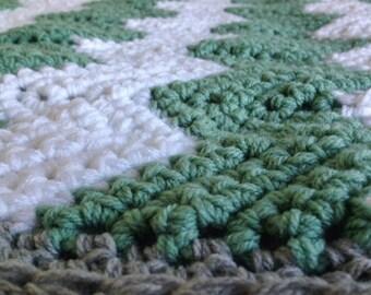 Green white and grey chevron blanket