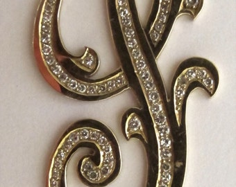 14Kt. Yellow gold S pendant with diamonds