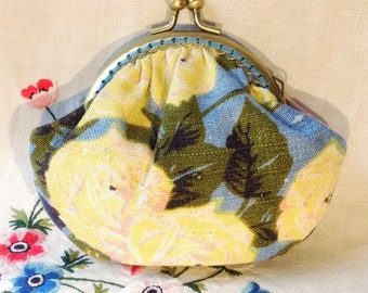 Frame purse made with vintage linen fabric