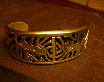 Sterling Silver Inca Indian Mexican Cuff Bracelet with 2 dimensional figures Artist made
