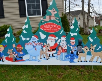 Santa Claus and Rudolph and the misfit toys at Christmas lawn stake