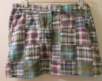 Vintage Madras plaid micro mini skirt by Millinium. Generous size 10. Great condition.