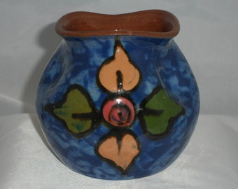 Pinched pot by Royal Torquay Pottery. Unusual pinched design decorated in a mottled  blue glaze with stylized floral motif