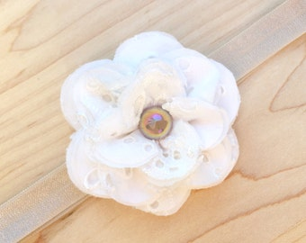 Shabby Chic Newborn Baby Headband — Ivory Eyelet Lace Fabric Flower with Iridescent Latte Pearl on Tan Stretch Elastic