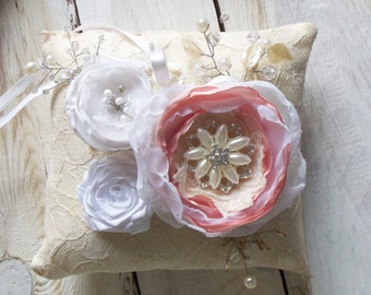 Wedding ring pillows in soft tones