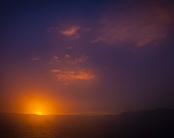 deep blue sky with brilliant hues of  sunrise.