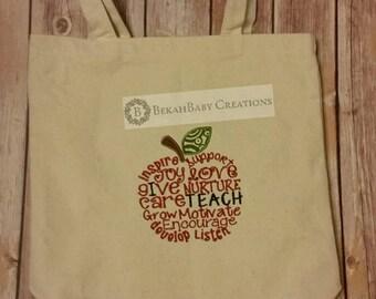 Apple-embroidered teacher bag