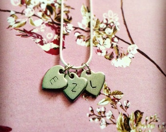 Personalised, hand stamped heart necklace.