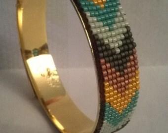 natif style narrow band on a gold metal bracelet