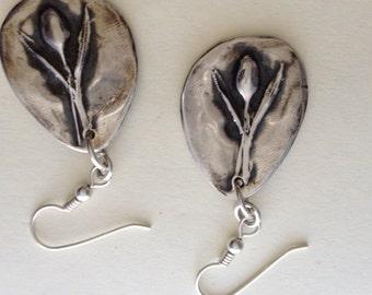Fine silver pod dangle earrings.