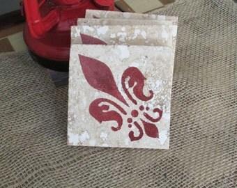 Fleur de Lis Travertine Coasters
