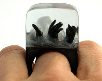 Zombie – creepy undead ring with three black hands and fog on a black ring made of resin