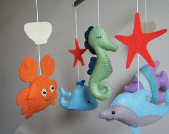 Mobile ocean dolphin, crab, whale, seahorse and fish
