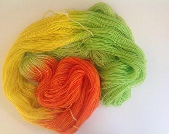 sock yarn , hand dyed sock yarn, Superwash wool and nylon blend . Orange , lemon and lime, citrus colors. Knitting yarn.