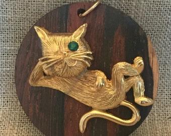 Vintage Sassy Lounging Cat Pendant: gold tone mounted on wood