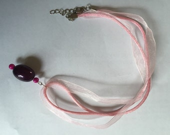Pink necklace with purple miracle bead