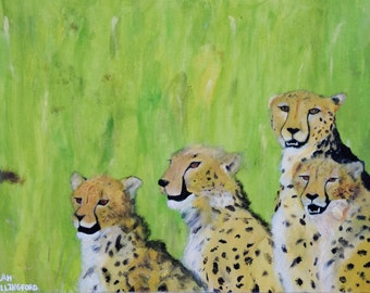A Cheetah And Her Cubs