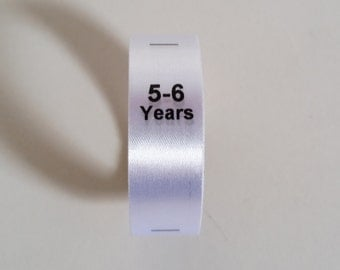 5-6 yrs size labels. Sew in White Satin Ribbon with Black print. Baby and Toddler Clothing Tags