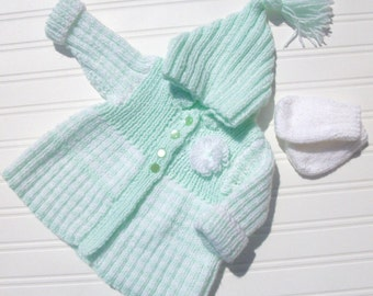 Hand knitted baby coat