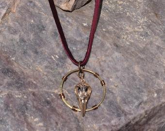 Burgundy Leather, Brass, and Bronze Bird Skull Necklace. Item 118.
